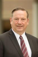 Dr. Christopher L. Holoman